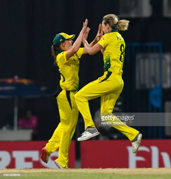 Ellyse Perry of Australia celebrates the dismissal of Amy Jones of England during the ICC Women's World T20 final cricket match between Australia and...