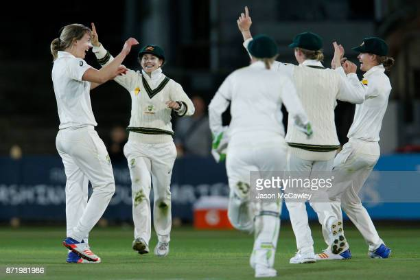 Ellyse Perry of Australia celebrates the dismissal of Sarah Taylor of England during the Women's Test match between Australia and England at North...