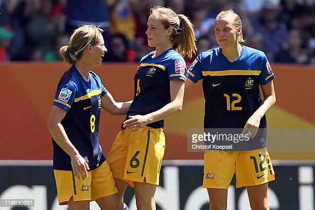 Ellyse Perry of Australia celebrates the first goal with Elise KellondKnight of Australia and Emily van Egmond of Australia during the FIFA Women's...