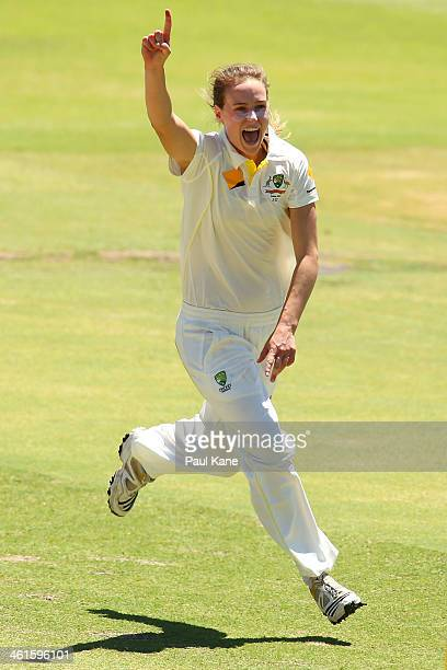 Ellyse Perry of Australia celebrates the wicket of Sarah Taylor of England during day one of the Women's Ashes Test match between Australia and...
