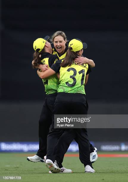 Ellyse Perry of Australia celebrates with Annabel Sutherland after they dismissed Shafali Verma of India during the ICC Women's T20 Cricket World Cup...