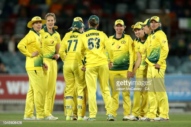 Ellyse Perry of Australia celebrates with team mates after dismissing Suzie Bates of New Zealand during game three of the Twenty20 series between...