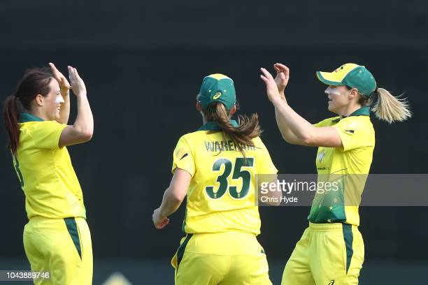Ellyse Perry of Australia celebrates with team mates after taking a catch to dismiss Sophie Devine of New Zealand during game two of the Women's...