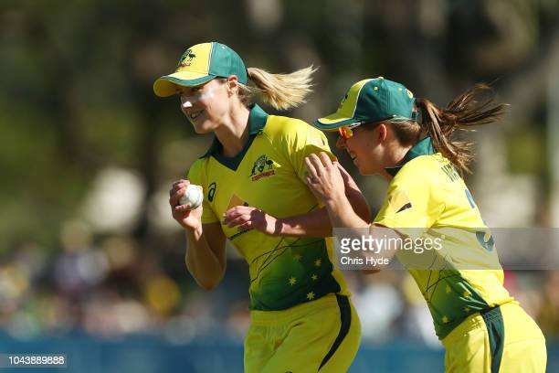 Ellyse Perry of Australia celebrates with team mates after taking a catch to dismiss Jess Watkin of New Zealand during game two of the Women's...