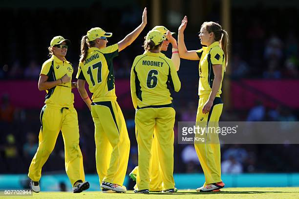 Ellyse Perry of Australia celebrates with team mates after taking the wicket of Smriti Mandhana of India during the International Twenty20 match...