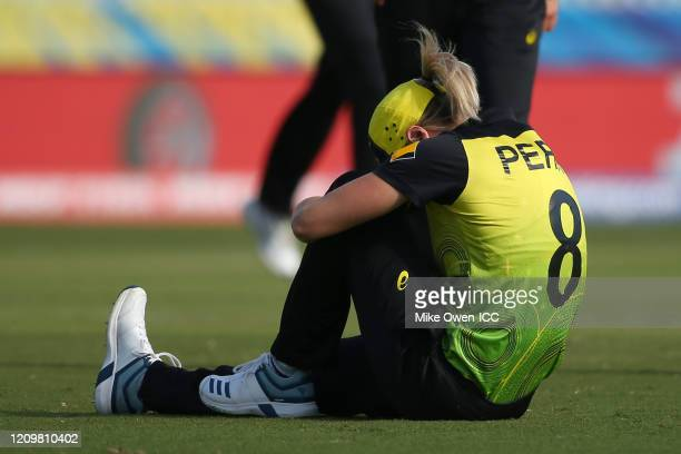 Ellyse Perry of Australia goes down during the ICC Women's T20 Cricket World Cup match between Australia and New Zealand at Junction Oval on March 02...