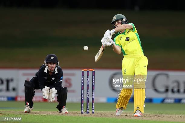 Ellyse Perry of Australia hits the ball during game three of the One Day International series between the New Zealand White Ferns and Australia at...