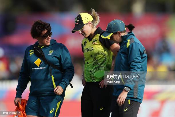 Ellyse Perry of Australia is taken from the field injured during the ICC Women's T20 Cricket World Cup match between Australia and New Zealand at...
