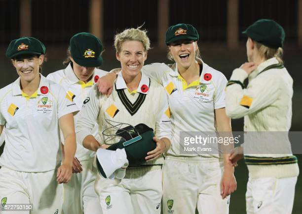 Ellyse Perry of Australia laughs as she walks off at stumps on day three of the Women's Test match between Australia and England at North Sydney Oval...