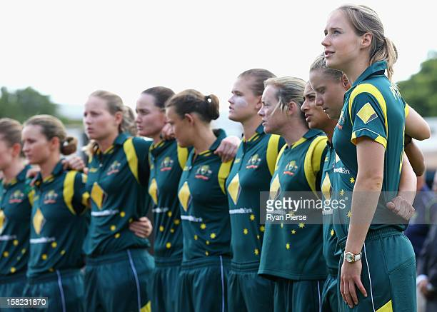 Ellyse Perry of Australia looks on during the national anthem during the first Rose Bowl Series One Day International match between Australia...