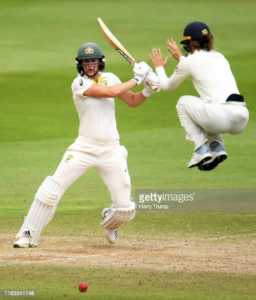 Ellyse Perry of Australia plays a shot as Amy Jones of England dives for the ball during Day Four of the Kia Women's Test Match between England Women...