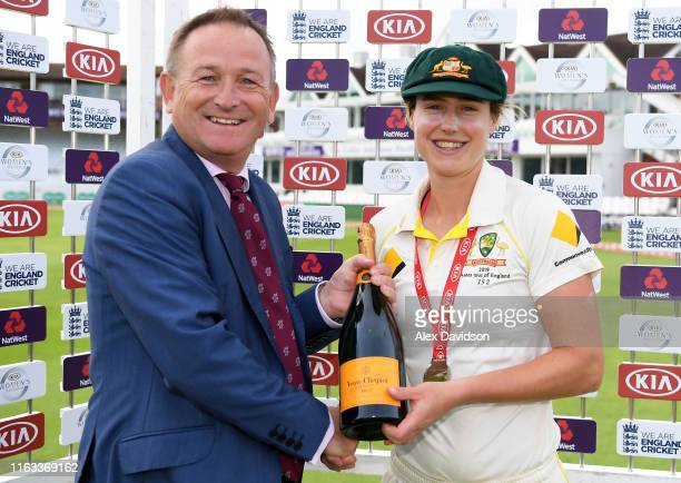 Ellyse Perry of Australia receives the Kia Player of the Match award from Somerset CCC CEO Andrew Cornish during Day Four of the Kia Women's Test...