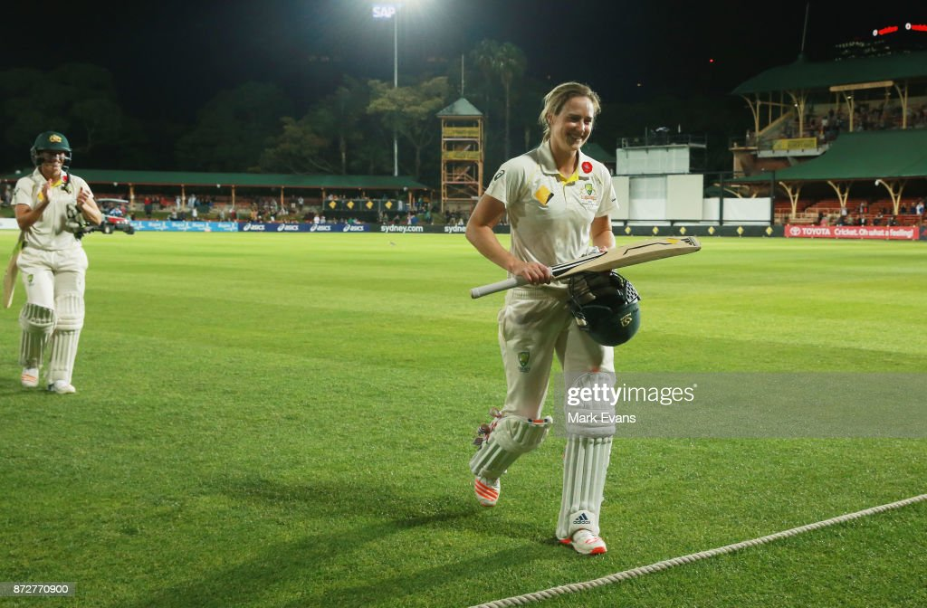 Ellyse Perry of Australia salutes the crowd after making 213 runs before Australia declared during day three of the Women's Test match between Australia and England at North Sydney Oval on November 11, 2017 in Sydney, Australia.