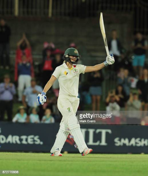 Ellyse Perry of Australia salutes the crowd after making 213 runs before Australia declared during day three of the Women's Test match between...