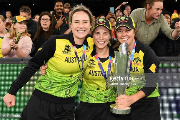 Ellyse Perry of Australia Sophie Molineux of Australia and Molly Strano of Australia celebrate after winning the ICC Women's T20 Cricket World Cup...