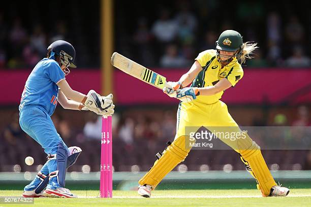 Ellyse Perry of Australia switch hits during the International Twenty20 match between Australia and India at Sydney Cricket Ground on January 31 2016...