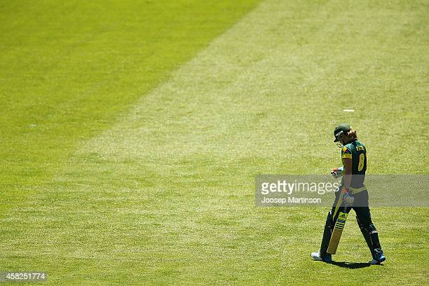 Ellyse Perry of Australia walks off the field after being dismissed by Anisa Mohammed of West Indies during the women's International Twenty20 match...