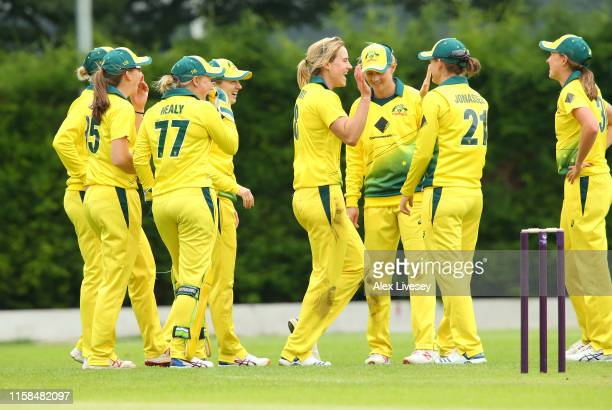 Ellyse Perry of Australia Women celebrates taking the wicket of Alice Davidson Richards of England Women's Academy during the match between England...