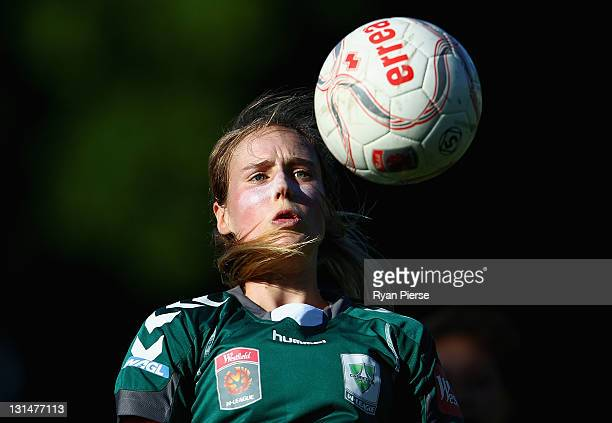 Ellyse Perry of Canberra heads the ball during the round three W-League match between Sydney FC and Canberra United at Leichhardt Oval on November 5,...