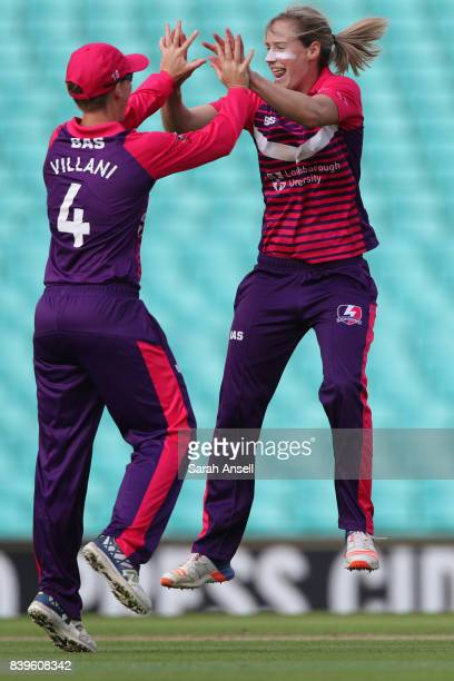 Ellyse Perry of Loughborough Lightning celebrates with compatriot Elyse Villani after taking the wicket of Lizelle Lee of Surrey Stars during the Kia...