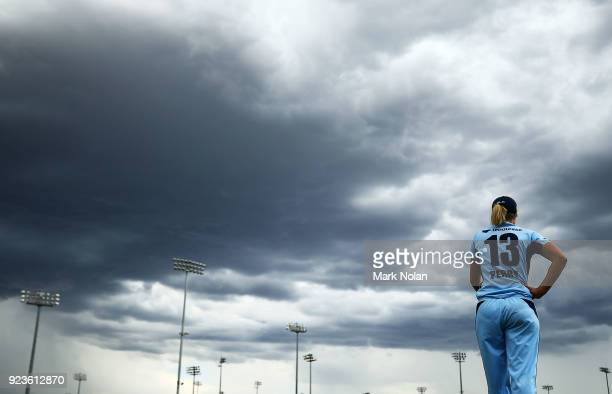 Ellyse Perry of NSW fields on the boundary as storm clouds gather during the WNCL Final match between New South Wales and Western Australia at...