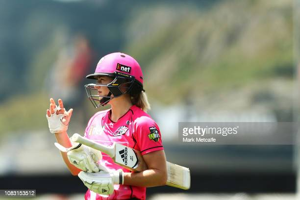 Ellyse Perry of the Sixers adjusts her helmet during the Women's Big Bash League match between the Sydney Sixers and the Hobart Hurricanes at...