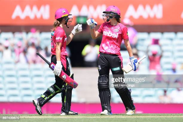 Ellyse Perry of the Sixers and Erin Burns of the Sixers celebrate victory during the Women's Big Bash League match between the Sydney Sixers and the...