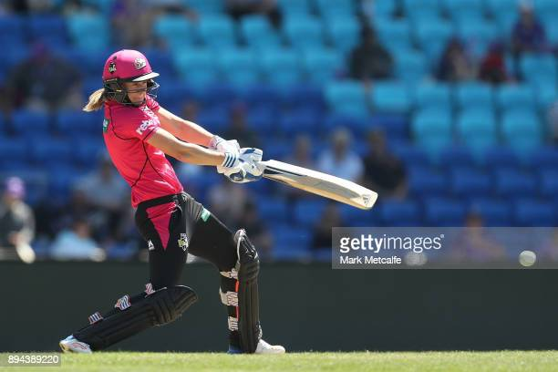 Ellyse Perry of the Sixers bats during the Women's Big Bash League match between the Hobart Hurricanes and the Sydney Sixers at Blundstone Arena on...