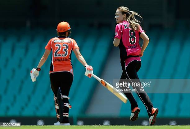 Ellyse Perry of the Sixers celebrates after taking the wicket of Charlotte Edwards of the Scorchers during the Women's Big Bash League match between...