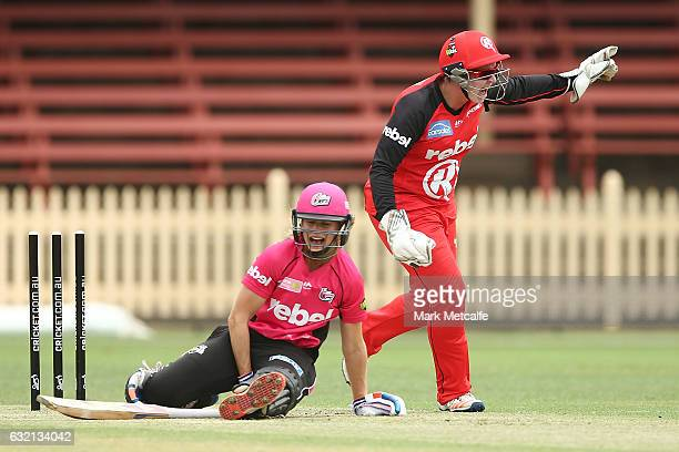 Ellyse Perry of the Sixers is stumped by Rachel Priest of the Renegades off the bowling of Molly Strano of the Renegades during the Women's Big Bash...