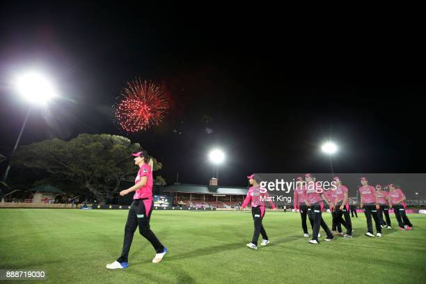 Ellyse Perry of the Sixers leads the Sixers from the field after victory during the Women's Big Bash League WBBL match between the Sydney Sixers and...