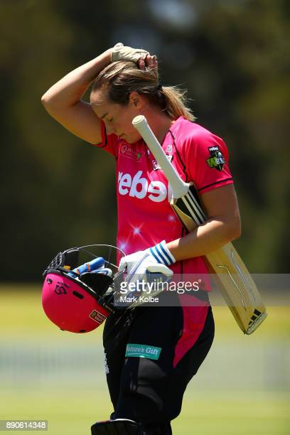 Ellyse Perry of the Sixers looks dejected as she leaves the field after being dismissed during the Women's Big Bash League match between the Perth...