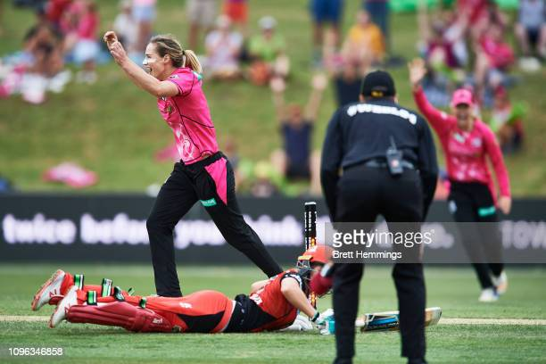 Ellyse Perry of the Sixers reacts to the runout wicket of Sophie Molineux of the Renegades during the Women's Big Bash League match between the...