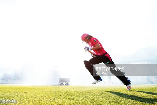 Ellyse Perry of the Sixers runs onto the field to bat during the Women's Big Bash League WBBL match between the Sydney Sixers and the Melbourne Stars...