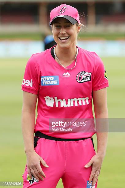 Ellyse Perry of the Sixers takes part in the bat toss during the Women's Big Bash League WBBL match between the Sydney Sixers and the Adelaide...