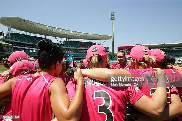 Ellyse Perry of the Sixers talks to teammates in a huddle after victory in the Women's Big Bash League match between the Sydney Sixers and the Perth...