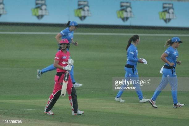 Ellyse Perry of the Sixers walks from the field for a rain delay during the Women's Big Bash League WBBL match between the Sydney Sixers and the...