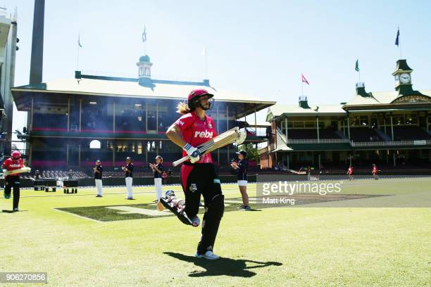 Ellyse Perry of the Sixers walks onto the field to bat during the Women's Big Bash League match between the Sydney Sixers and the Brisbane Heat at...