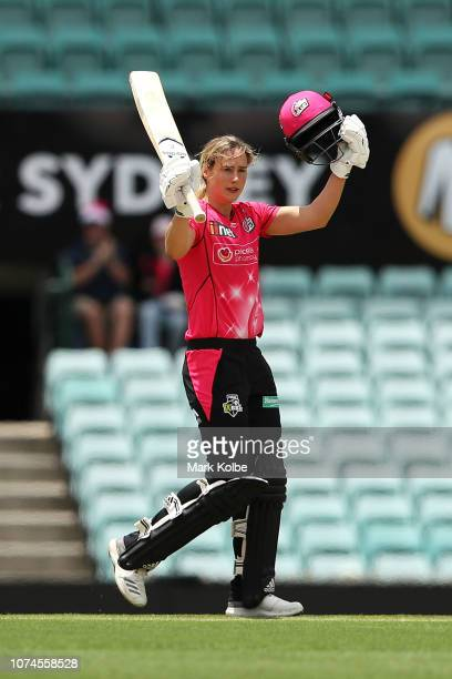 Ellyse Perry of the Sydney Sixers celebrates her century during the Women's Big Bash League match between the Sydney Sixers and the Brisbane Heat at...