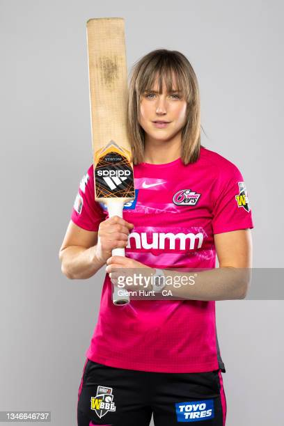 Ellyse Perry of the Sydney Sixers poses during the Sydney Sixers Women's 2021/22 Cricket Headshots session at the National Cricket Centre on...