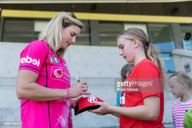 Ellyse Perry of the Sydney Sixers signs autographs during the Women's Big Bash League media opportunity at Drummoyne Oval on January 18 2019 in...