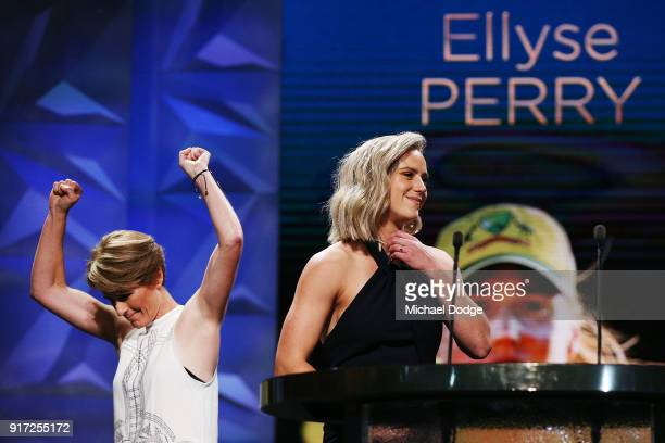 Ellyse Perry receives the Belinda Clark Award from Belinda Clark who raises her arms afer finally getting the necklace around her neck at the 2018...