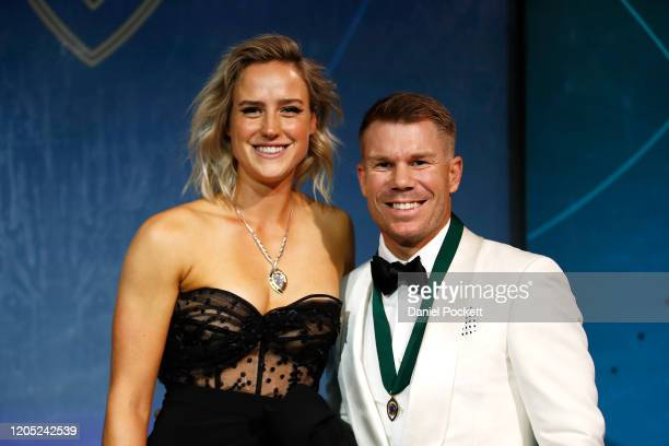 Ellyse Perry winner of the Belinda Clark Award poses with David Warner winner of the Allan Border Medal during the 2020 Cricket Australia Awards at...