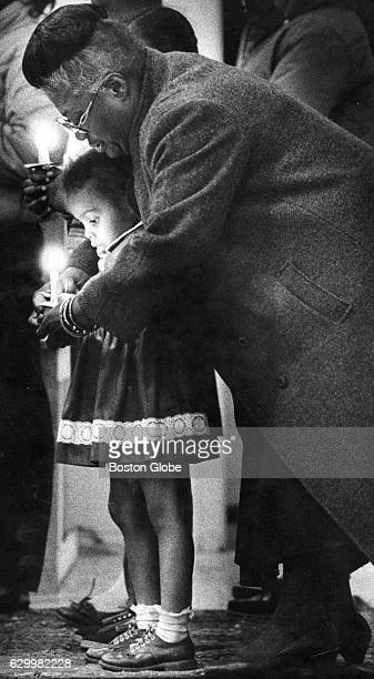 Elma Lewis shows a child how to hold a candle during a rehearsal for the AfroAmerican Artists' production of Langston Hughes' Black Nativity in...
