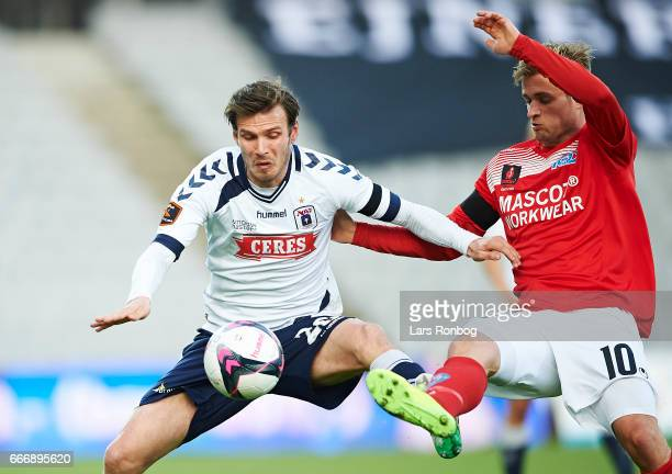 Elmar Bjarnason of AGF Aarhus and Emil Scheel of Silkeborg IF compete for the ball during the Danish Alka Superliga match between AGF Aarhus and...