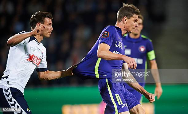 Elmar Bjarnason of AGF Aarhus and Jonas Borring of FC Midtjylland compete for the ball during the Danish Alka Superliga match between AGF Aarhus and...