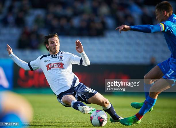 Elmar Bjarnason of AGF Aarhus and Kasper Risgard of AaB Aalborg compete for the ball during the Danish Alka Superliga match between AGF Aarhus and...