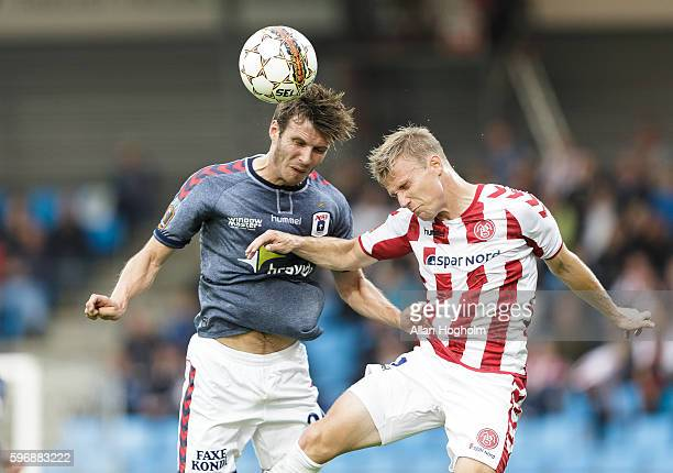 Elmar Bjarnason of AGF and Patrick Kristensen of AaB compete for the ball during the Danish Alka Superliga match between AaB Aalborg and AGF Aarhus...