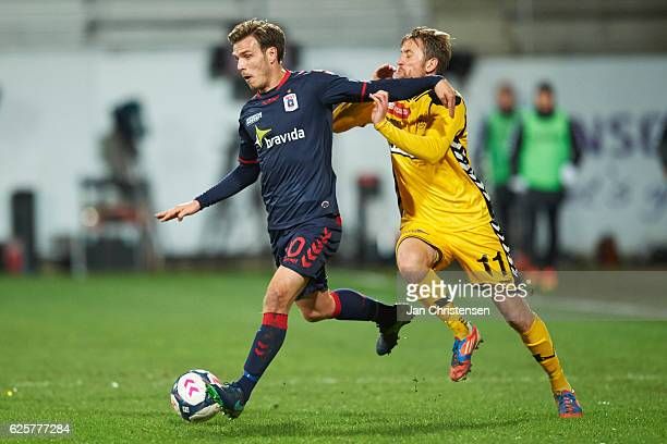 Elmar Bjarnason of AGF Arhus and Peter Nymann of AC Horsens compete for the ball during the Danish Alka Superliga match between AC Horsens and AGF...