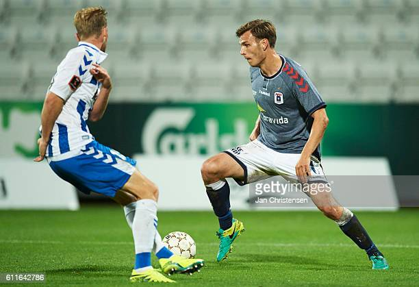 Elmar Bjarnason of AGF Arhus compete for the ball during the Danish Alka Superliga match between OB Odense and AGF Arhus at TREFOR Park on September...